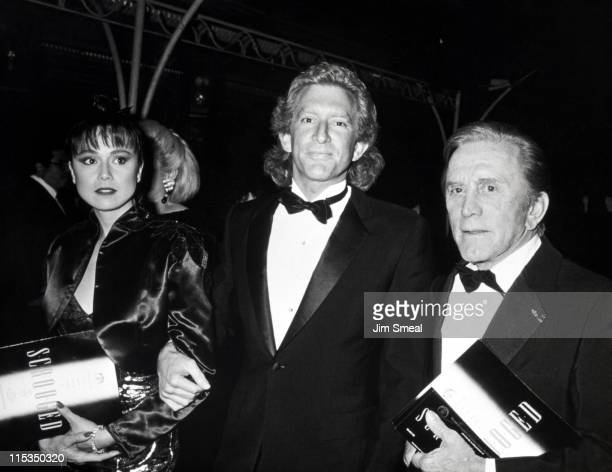 Peter Douglas with Wife and Kirk Douglas during World Premiere of 'Scrooged' at Mann Chinese Theater in Hollywood California United States