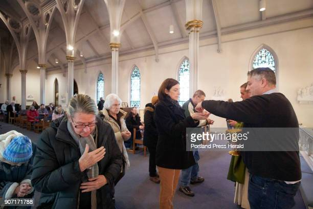 Peter Doyle right an eucharistic minister at the Cathedral of the Immaculate Conception in Portland serves communion in the Sacred Heart Chapel at...