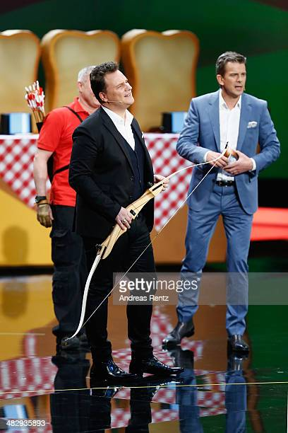 Peter Dubberstein Guido Maria Kretschmer and Markus Lanz seen on stage during the 'Wetten dass' tv show on April 5 2014 in Offenburg Germany