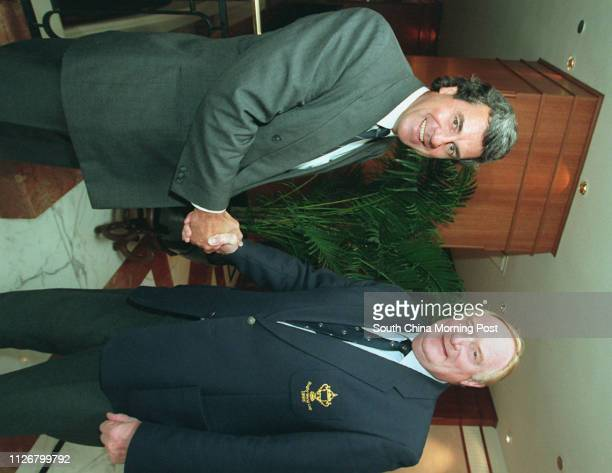 Peter Duncan chairman of RNC Organising Committee shake hands with Keith Rowlands secretary of International Rugby Football Board They have meeting...