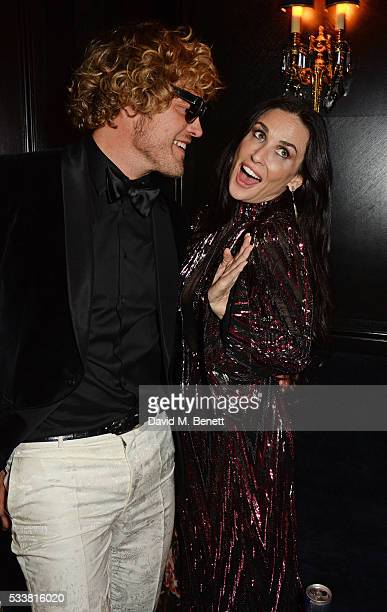 Peter Dundas and Demi Moore attend British Vogue's Centenary birthday party at Tramp on May 23 2016 in London England