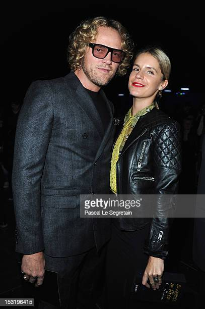Peter Dundas and Eugenie Niarchos attend the Saint Laurent Spring / Summer 2013 show as part of Paris Fashion Week on October 1 2012 in Paris France