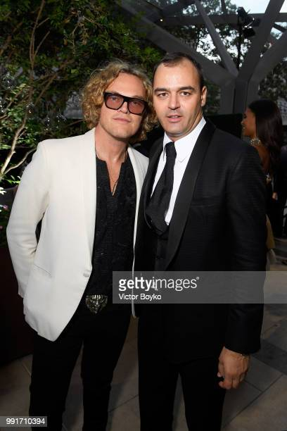Peter Dundas and Milutin Gatsby attend amfAR Paris Dinner 2018 at The Peninsula Hotel on July 4 2018 in Paris France
