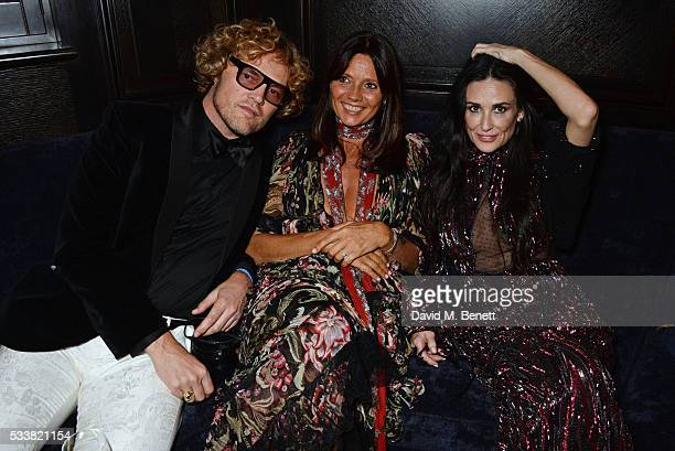 Peter Dundas Countess Debonnaire von Bismarck and Demi Moore attend British Vogue's Centenary birthday party at Tramp on May 23 2016 in London England