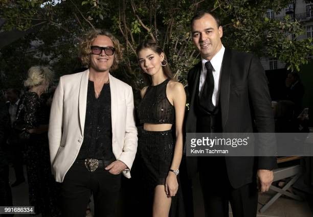 Peter Dundas Helena Gatsby and Milutin Gatsby attend the amfAR Paris Dinner at The Peninsula Hotel on July 4 2018 in Paris France