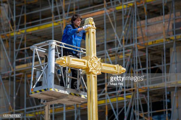 Peter Durku, metal designer, works on the cross on the lantern for the dome of the Berlin City Palace that will anoint the rebuilt Berlin City Palace...