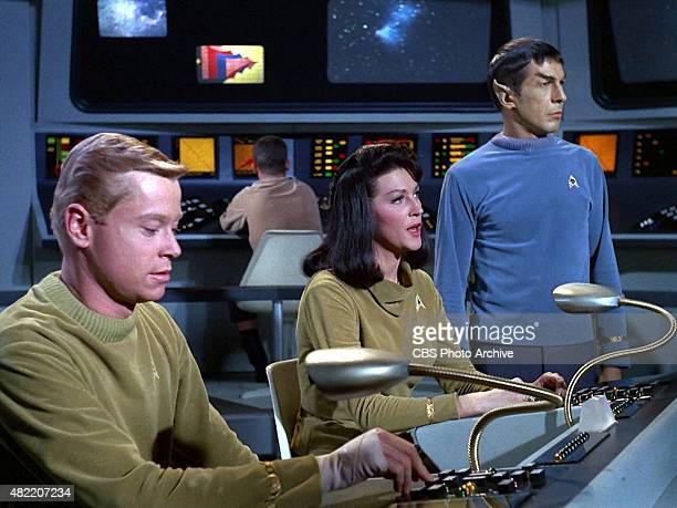 Peter Duryea as Lieutenant Jos Tyler Majel Barrett as Number One and Leonard Nimoy as Commander Spock on the bridge of the USS Enterprise in the STAR...