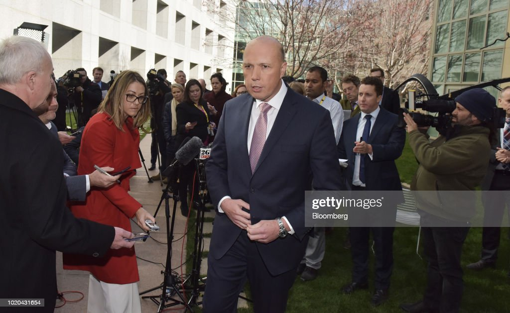 Peter Dutton, Australia's former minister of home affairs, center, leaves a news conference in Canberra, Australia, on Tuesday, Aug. 21, 2018. Australia's Prime Minister Malcolm Turnbull survived a leadership vote on Tuesday but may be challenged again within days amid growing unease among party colleagues about the government's slumping poll ratings. Photographer: Mark Graham/Bloomberg via Getty Images