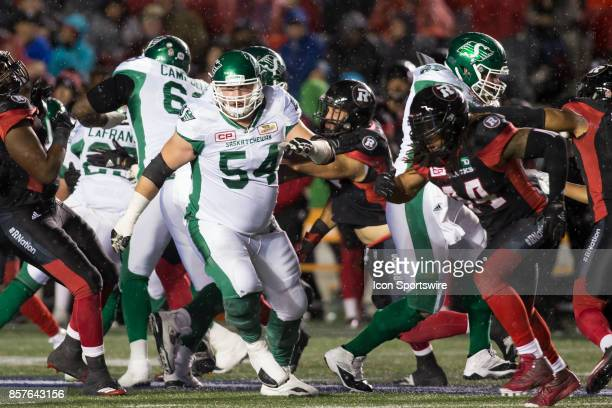 Peter Dyakowski of the Saskatchewan Roughriders pushes through the Ottawa Redblacks defence The Saskatchewan Rough Riders defeated the Ottawa...