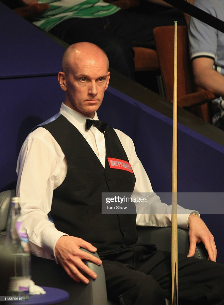 Peter Ebdon of England looks on in his match against Ronnie O'Sullivan of England during the first round of the Betfred.com World Snooker Championship at Crucible Theatre on April 24, 2012 in Sheffield, England.