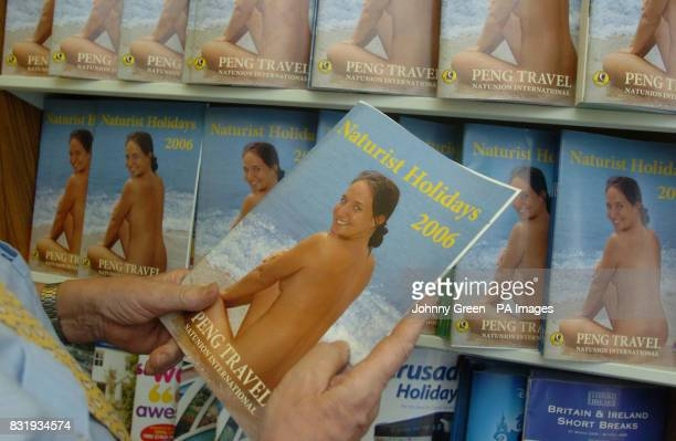 Peter Englert originally hailing from Berlin in Germany holds a Naturist Holidays 2006 brochure inside Peng Travel located at Gidea Park near Romford...