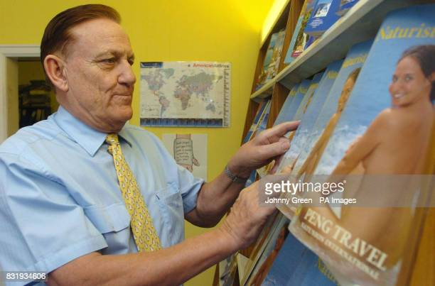 Peter Englert originally hailing from Berlin in Germany looks at a Peng Travel Naturist Holidays 2006 brochure inside Peng Travel located at Gidea...