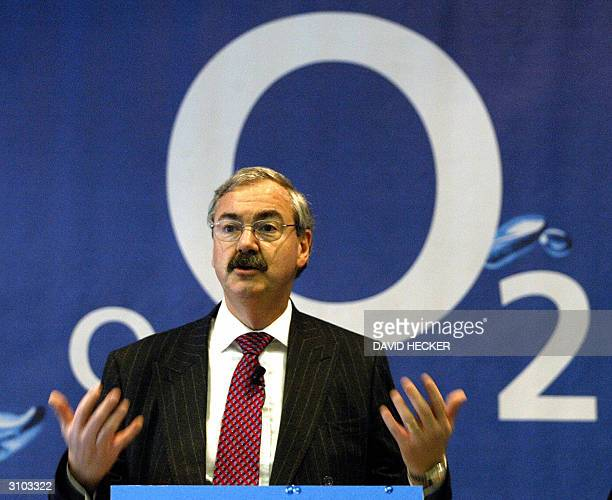 Peter Erskine, President of mobile operators O2 International gestures during a presentation at the CeBIT 2004 computer technology fair in Hanover 17...