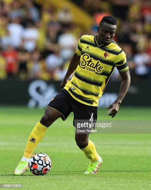 Peter Etebo of Watford runs with the ball during the Premier League match between Watford and Wolverhampton Wanderers at Vicarage Road on September...