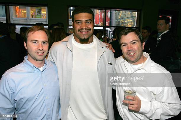 Peter Everett and Brandon Funston of Yahoo pose for a photograph with Shawne Merriman of the San Diego Chargers at the Fantasy Sports Association...