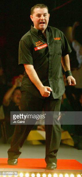 Peter Evison celebrates during the 2005 Ladbrokescom World Darts Championship at The Circus Tavern on December 27 2004 in Purfleet England