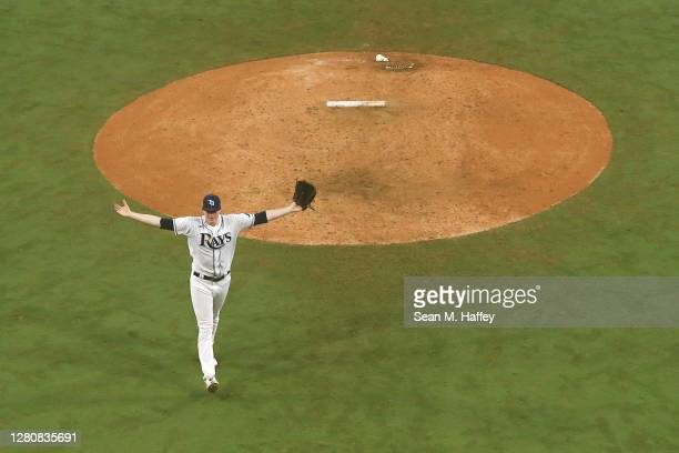 Peter Fairbanks of the Tampa Bay Rays celebrates a 4-2 win against the Houston Astros to win the series in Game Seven of the American League...