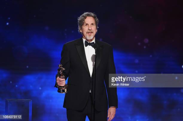 Peter Farrelly presents the Charlie Chaplin Britannia Award for Excellence in Comedy presented by Jaguar Land Rover onstage at the 2018 British...