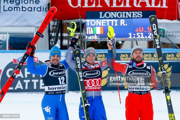 Peter Fill of Italy takes 2nd place Alexis Pinturault of France takes 1st place Kjetil Jansrud of Norway takes 3rd place during the Audi FIS Alpine...