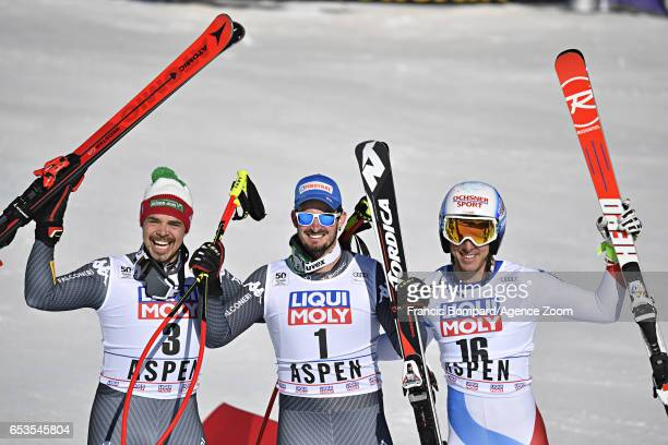 Peter Fill of Italy takes 2nd place Dominik Paris of Italy takes 1st place Carlo Janka of Switzerland takes 3rd place during the Audi FIS Alpine Ski...