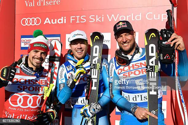 Peter Fill of Italy takes 2nd place Kjetil Jansrud of Norway takes 1st place Aksel Lund Svindal of Norway takes 3rd place during the Audi FIS Alpine...