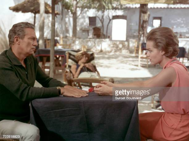 Peter Finch and Romy Schneider on the set of '1030 PM Summer' directed by Jules Dassin 1965 In the background is Melina Mercouri
