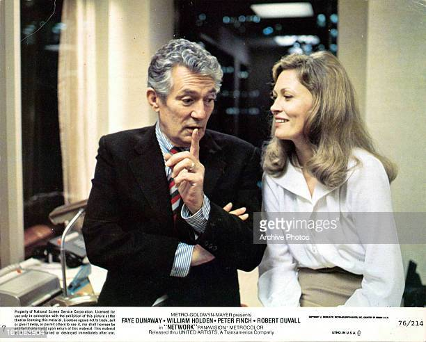Peter Finch making point to Faye Dunaway in a scene from the film 'Network' 1976