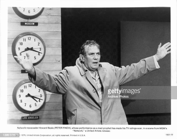Peter Finch performing as the mad on air prophet in a scene from the film 'Network' 1976