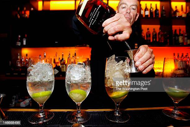 Peter Fitzmaurice the 1331 Bar and Lounge bartender of 33 years makes the Rickya lot of parts gin or bourbon half a lime and soda water at the party...