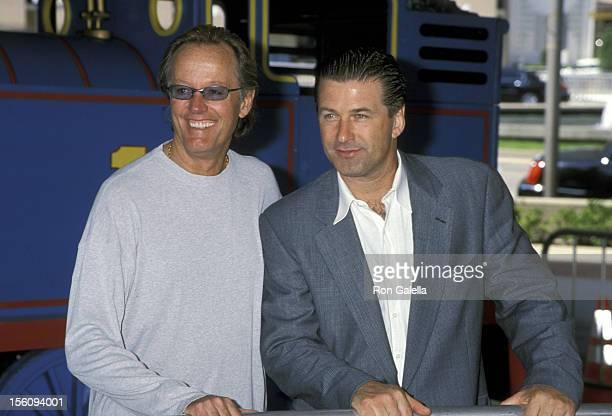 Peter Fonda and Alec Baldwin during 'Thomas and the Magic Railroad' Premiere at Cineplex Odeon Century Plaza Cinema in Century City California United...