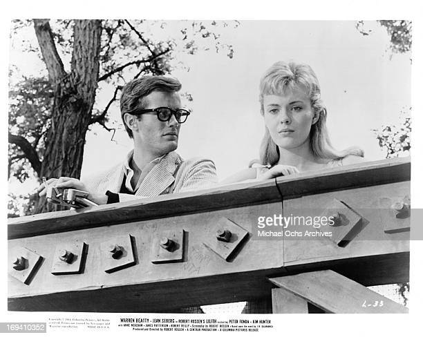 Peter Fonda and Jean Seberg standing at railing in a scene from the film 'Lilith', 1964.