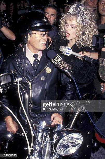 Peter Fonda and Judy Tenuta attend the grand opening of the HarleyDavidson Cafe on October 19 1993 in New York City