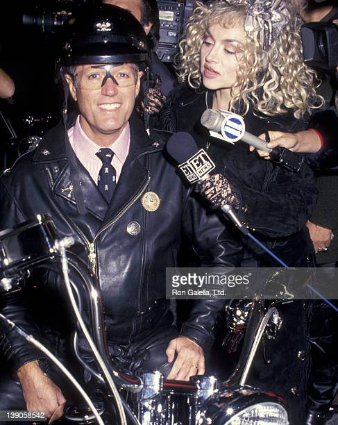 Peter Fonda and Judy Tenuta attend the grand opening of the Harley-Davidson Cafe on October 19, 1993 in New York City.