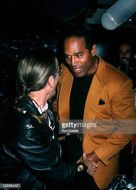 Peter Fonda and O.J. Simpson during Grand Opening of The Harley Davidson Cafe at Harley Davidson Cafe in New York City, New York, United States.