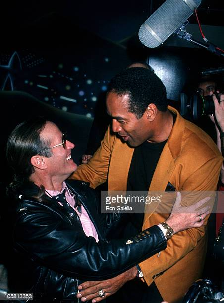 Peter Fonda and OJ Simpson during Grand Opening of The Harley Davidson Cafe at Harley Davidson Cafe in New York City New York United States