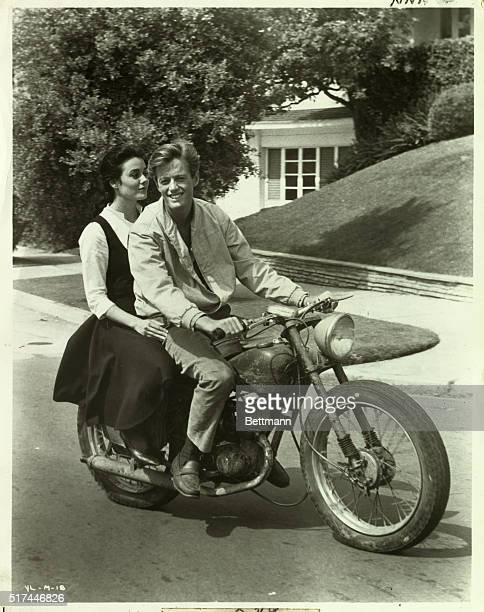 Peter Fonda and Sharon Hugueny share a motorbike in a scene from The Young Lovers Undated photograph