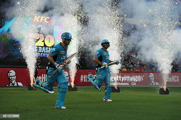 Peter Forrest and James Peirson of the Heat run ontot hte field during the Big Bash League match between the Brisbane Heat and Sydney Sixers at The...