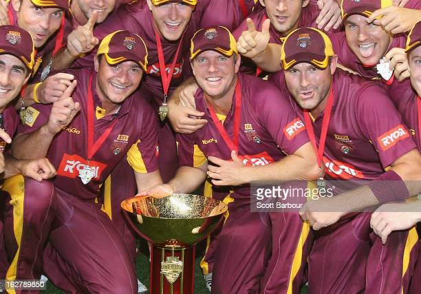 Peter Forrest James Hopes and Ryan Harris of the Bulls pose with the Ryobi One Day Cup after winning the Ryobi One Day Cup final match between the...