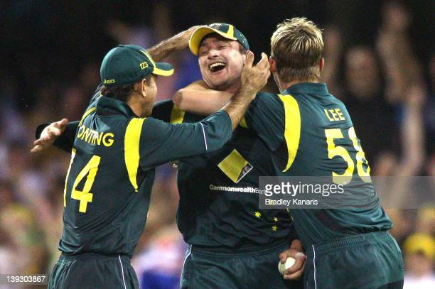 Peter Forrest of Australia celebrates with team mates after catching out Ravindra Jedeja of India during game seven of the One Day International...