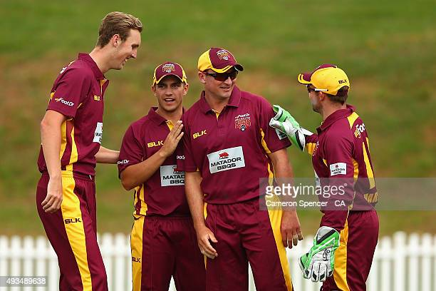 Peter Forrest of Queensland is congratulated after catching out Adam Voges of Western Australia off the delivery of Billy Stanlake during the Matador...