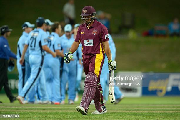 Peter Forrest of Queensland leaves the field after being dismissed by Steve O'Keefe of NSW during the Matador BBQs One Day Cup match between...