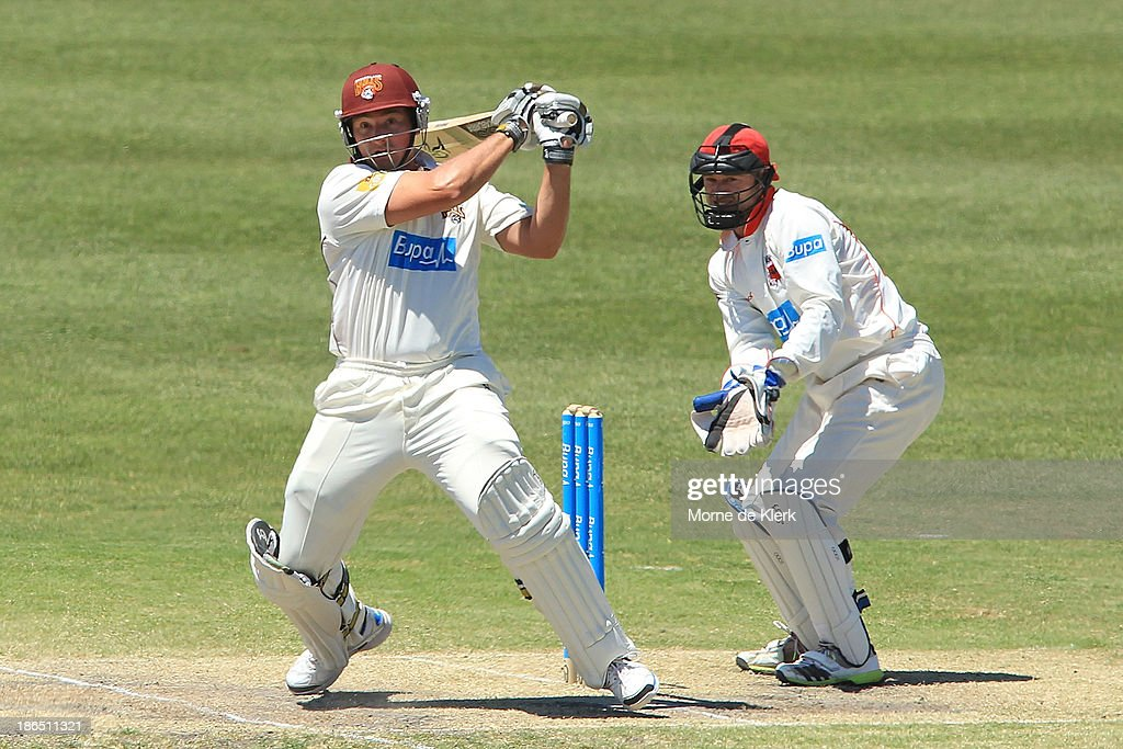 Peter Forrest of the Bulls bats in front of Tim Ludeman of the Redbacks during day three of the Sheffield Shield match between the South Australia Redbacks and the Queensland Bulls at Glenelg Oval on November 1, 2013 in Adelaide, Australia.