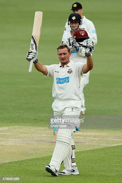 Peter Forrest of the Bulls celebrates his century during day two of the Sheffield Shield match between Queensland and Western Australia at The Gabba...