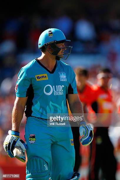 Peter Forrest of the Heat leaves the field after being dismissed by Ashton Turner of the Scorchers during the Big Bash League match between the Perth...