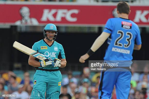 Peter Forrest of the Heat speaks with Kane Richardson of the Strikers during the Big Bash league match between the Brisbane Heat and the Adelaide...