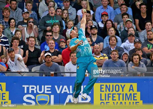 Peter Forrest of the Heat takes a one handed catch in the outfield to dismiss Jos Buttler of the Renegades during the Big Bash League match between...