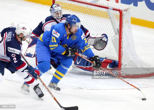 Peter Forsberg of Sweden attempts to score against goalie Mike Dunham and defenseman Brett Hauer of the USA during the Semifinals match at the...