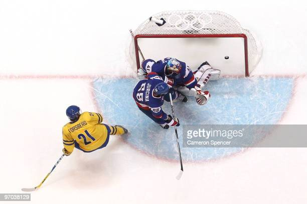 e7bfe7869 Peter Forsberg of Sweden scores past goalkeeper Jaroslav Halak of Slovakia  during the ice hockey men's