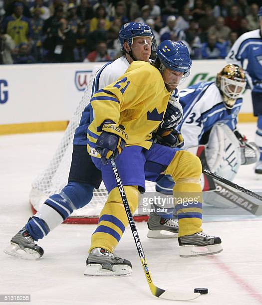 Peter Forsberg of Sweden shields off a defender as he skates the puck into the slot during the World Cup of Hockey against Finland on September 4,...