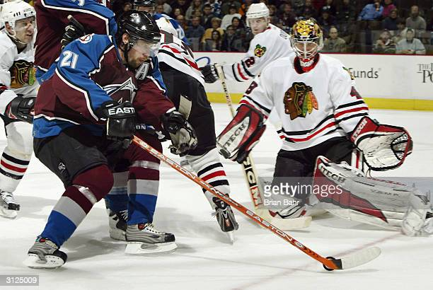 Peter Forsberg of the Colorado Avalanche can't get a good angle on goalie Michael Leighton of the Chicago Blackhawks in overtime March 23 2004 at the...